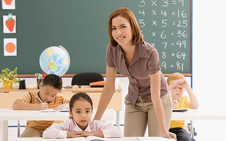 Female teacher teaching her students in a classroom